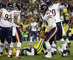shea mcclellin chicago bears   lays on the ground after being sacked by Chicago Bears' Shea McClellin ...