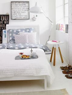 This bedroom is dreamy and calming.  A great use of bold patterns in the bedroom while still remaining understated.