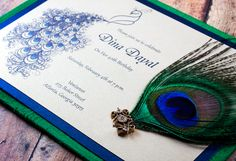 Peacock Indian wedding invitation - Fluid peacock design adorned with a peacock feather and swarovski crystal completed with a green dupioni silk background