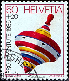 Switzerland.  Children's Toys.  Top.  Surtax was for youth welfare organizations and the Pro Juventute Foundation. Scott  B528 SP255, Issued 1986 Nov. 25, Photo.,  50c + 20c. /ldb.
