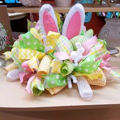 Easter Bunny Ears table centerpiece by Whimsy Wreaths  https://www.etsy.com/shop/WhimsyWreathsDesigns