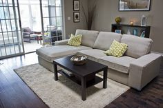 Kivik couch - dark floors, light rug, dark coffee table.