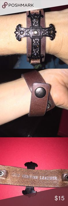 Cross leather bracelet No stones missing great shape . Is gender neutral ... the strap is brown. Not free people Free People Jewelry Bracelets
