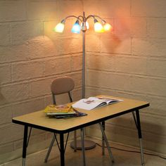 We were *just* talking about making the classroom feel more welcoming by using lamps!  The adjustable lights on this are perfect!