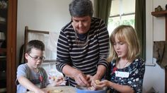 Epsom resident Kay Hawk bakes with her grandchildren Luca Hill, 7, and Hunter Taylor, 7.