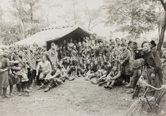 ..: Group portrait of the 35° Battalion CC.NN. Sector Valdurasca during a tactic drill Keywords:	 Military Camp  - 	 Tent  - 	 Armed Forces and Military Life  - 	 Armed Forces  - 	 Rifle  - 	 Armed Forces  - 	 Soldier  - 	 Military  - 	 Uniform  - 	 Male  -  Bicycle  - 	 Tree   Photographer: Zancolli Rodolfo (1885-1962) Date of photography: 28-29/06/1930 :..