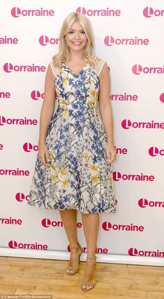 Flower power: Holly looked sensational in a pretty floral dress, that boasted mesh panels across the sleeves, and barely-there nude stilettos
