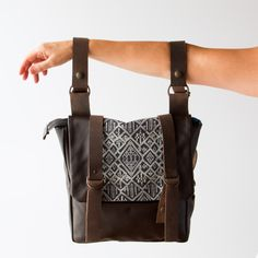 Model Holding A Brown Leather - Recycled Leather & Cotton Backpack / Shoulder Bag - Handmade in Canada - Chic & Basta