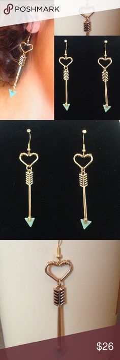 HPLong gold turquoise arrow earrings heart ❤❤️BUNDLE and SAVE❤️️Long gold turq arrow earrings wire wrapped heart.  This is a very unique long pair of earrings with gold colored arrow and turquoise Arrow tip.  Gold colored hardware and gold colored wire wrapped heart. New and never used Jewelry Earrings