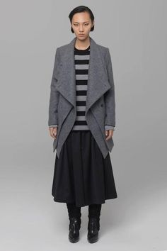 UNCONDITIONAL's new double layer asymmetriclong coat with zipout panel.Featuring frontpocketsand buttons. Made in 100 % pure softwool coating. Fully lined. Colour : Black. Product code :WCOT144 Care instructions : Dry clean only, iron medium, do not tumble dry, do not bleach.
