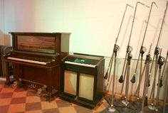 Upright piano (left) versus celesta (right) in a home storeroom for comparison