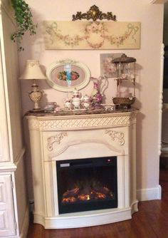 Romantic electric fireplace with Christy Repasy prints!