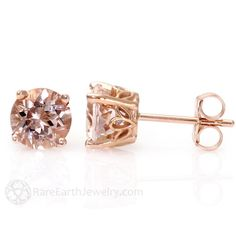 A simply stunning pair of natural Morganite gemstone stud earrings set in your choice of 14K White, Yellow or Rose Gold floral settings. These sizes are available: 5mm - .50ct each (1.00ct total weight) 6mm - .75ct each (1.50ct total weight) 8mm - 2.00ct each (4.00ct total weight) Morganite is a soft pink to peach color, and is in the same gem family as Emerald and Aquamarine. This gem was originally discovered by Tiffany gemologist, James Kunz, and named after his friend, American banker…
