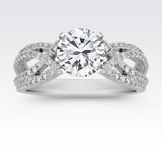 Split Shank to Crossing Round Diamond Engagement Ring with Brilliant Round Diamond from Shane Co. Available with your choice of ruby, diamond or sapphire center stone.