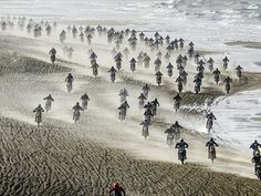 Competitors ride down the beach during the Red Bull Knock Out race in The Hague, Netherlands,  Remko De Waal, European Pressphoto Agency