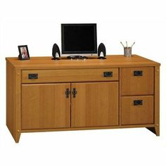 """Bush Mission Pointe Credenza by Bush. $409.99. Planked MapleKeyboard shelf is concealed by a drop-down frontConcealed compartment with fixed shelf for printer and CPURear wire accessSelf-closing European style hingesTwo file drawers holds letter-size filesSpecifications:Overall product dimensions: 59 1/4""""""""W X 23 3/8""""""""D X 29 1/2""""""""H"""