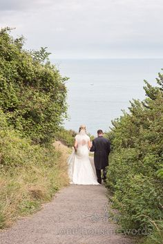 Couple walk away at Dorset Castle Wedding. Photography by one thousand words wedding photographers