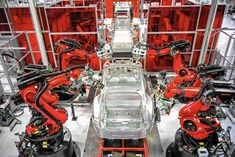 Tesla factory racing to retool for new models  FREMONT, Calif. — Xavier, Wolverine, Iceman, Thunderbird and Cyclops were all working hard.  http://www.latimes.com/business/autos/la-fi-hy-tesla-factory-20150215-story.html