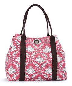 Perfect for on-the-go gals, this weekender makes a stylish companion for those occasions that require extra gear. Whether jetting around town or getting away for the weekend, its generous interior provides plenty of room for essential supplies. An interior snap allows the bag to be transformed into a more compact silhouette for maximum versatility.