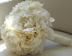 "Or these with red satin around the stems for yall;""White Peonies Hydrangea and Roses Bridal Bouquet"""