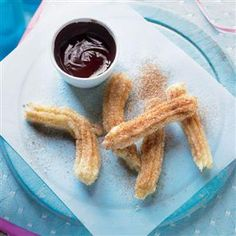 Chocolate and churros recipe. This is our version of the Spanish breakfast classic, a combination of doughnut-like fingers with thick hot chocolate. We say eat them at any time. Hot Chocolate Sauce, Chocolate Recipes, Chocolate Churros, Spanish Churros Recipe, Tapas Menu, Tapas Recipes, Uk Recipes, Cream Puff Recipe, Cooking App