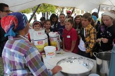 Making bannock at the Fall Harvest at Fort William Historical Park