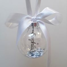 Items similar to Personalised Papercut Name Bauble, Keepsake Ornament, Baby's First Christmas Decoration, Xmas Paper Cut Gift on Etsy Christmas Baubles, Christmas Decorations, Paper Confetti, Glitter Cards, Etsy Christmas, Babies First Christmas, White Gift Boxes, Paper Cutting, Cricut