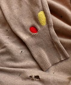 Fixing an old holey sweater with felting