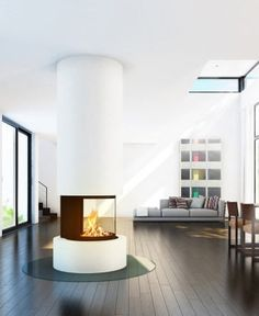 #Desgin central #fireplace (wood-burning closed hearth ) - ODEON by Rüegg Cheminées