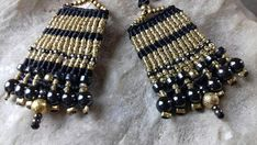 Check out this item in my Etsy shop https://www.etsy.com/listing/592778041/black-and-gold-earrings-macrame-fashion