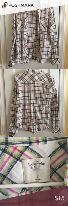 """Abercrombie & Fitch Flannel Shirt Fairly used pink, green, blue and white plaid patterned flannel shirt with two chest pockets. Clearly creased.  Measurements: 17 1/2"""" Chest, 17"""" Waist, 18"""" Seat, 5 1/4"""" Bicep, 25 7/8"""" Length, 15 1/2"""" Shoulder Width, 9 1/2"""" Cuff Circ, 15 1/4"""" Collar  Materials: 100% Cotton  Care: Machine Wash Abercrombie & Fitch Tops Tees - Long Sleeve"""