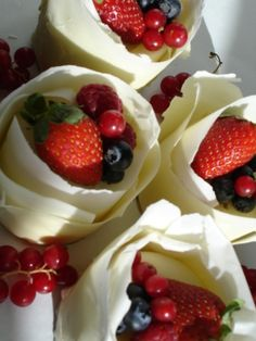 white chocolate rough wrapped mini cakes with fresh berries