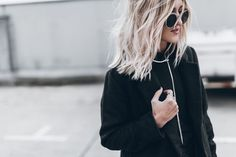 Modern glam streetstyle with Mikutas wearing silver statement long spike lariat choker necklace with black turtleneck and silver sequins skirt. Chic, modern and edgy street style. Shop more statement beautiful jewellery now