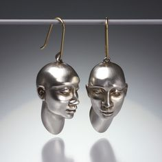 "The mastery with which Gabriella Kiss can sculpt is beautifully displayed in these sterling silver plain ""Head"" earrings.  The faces are simply stunning, perfectly proportioned and with a whimsical little smile.Gabriella Kiss' ""Head"" earrings measure 1 1/2"" x 3/4""."