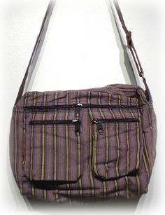 A cotton constructed shoulder bag, featuring a zipped opening plus exterior pockets, spacious for your stuff and perfect for casual outing. Comes with a single, adjustable strap Handmade creation from Baguio City, Philippines.