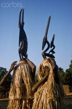 Africa | A Bambara man and woman wear antelope masks to dance to Tyi-Wara, the mythological half man, half antelope, who is believed to bring good luck to farmers. Mali. | Image and caption © Charles & Josette Lenars