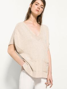CAPE SWEATER WITH POCKETS