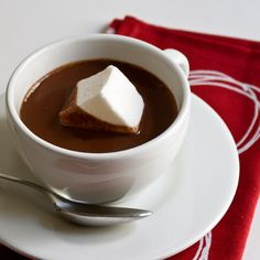 Classic Hot Chocolate: 7 cup(s) milk; 1 pound(s) bittersweet chocolate, chopped; 1 cup(s) heavy cream; 1 cup(s) sugar;  2 teaspoon(s) vanilla extract. Bring milk to a simmer in a small pan over low heat, then whisk in the remaining ingredients. For a chocolate bar: Let guests customize their own drinks with marshmallows, caramel syrup, peppermint sticks, and decanters of dark rum, vanilla vodka, and Bailey's.