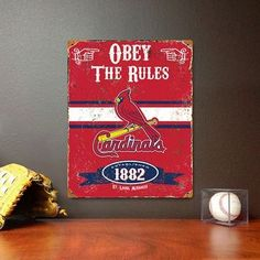 "Officially licensed St. Louis Cardinals vintage metal sign. Size: 11.5"""" wide x 14.5"""" long The Cardinals metal sign features a realistic weathered design and embossed lettering. This Party Animal MLB"