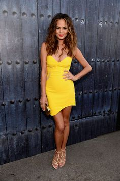Chrissy Teigen in a Three Floor dress, Casadei shoes, a Kotur clutch, and jewelry by Carla Amorim and Melinda Maria. LOVE HER HAIR Chrissy Teigen Photos, Christine Teigen, Vogue, Sweetheart Dress, Mellow Yellow, Yellow Dress, Dress Red, Party Fashion, Fashion Advice