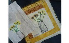 Almofada com desenho de girassol. Clique na imagem e confira algumas ideias de decoração! (Foto: Criações em Família e Cia.)