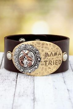"Stylish double guns with ""Mama Tried"" on a faux leather cuff is the perfect addition to your western jewelry collection!"