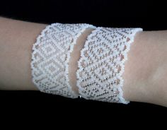 'lacey' bracelet that is not netted -  just peyote with white  either silver lined or transparent beads -  biser.info -