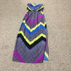Neon maxi dress Strapless dress. Elastic and tie at the waist. Has pockets. Slots on both sides to knee. Has a small pick on the front but is not noticeable. See pic. Dresses Maxi