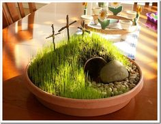 Plant an Easter Garden! Using potting soil, a tiny buried flower pot for the tomb, shade grass seed, & crosses made from twigs. Sprinkle grass seed generously on top of dirt, keep moistened using a spray water bottle. Spritz it several times a day. Set it in a warm sunny location. Sprouts in 7-10 days so plan ahead. The tomb is EMPTY! He is Risen! He is Risen indeed! Small Garden With Pebbles, Twig Crafts, Fun Crafts To Do, Easter Celebration, Craft Activities For Kids, Easter Activities, Centerpieces, Easter Centerpiece, Easter Religious