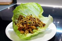 asian-lettuce-wraps just like joeys. 1/4 cup peanuts. 1 tbsp olive oil. 2 chicken breast cut into bit sized pieces. 3 cloves garlic minced. 1/2 onion chopped. 1/2 red pepper chopped. 250g water chestnuts sliced matchstick style. 2 tbsp soya sauce. 2 cups mushrooms sliced matchstick style. 1/2 tsp brown surgar. 5 tbsp hoisin sauce. 1 tbsp chili paste. 2 green onions thinly sliced. Head of Romain lettece for wrapping. Stream fried crispy Asian noodles.