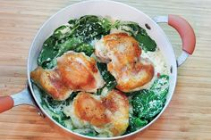 Skillet Browned Chicken with Creamy Greens | Ruled Me KETO 1 lb chicken thighs, boneless but skin on 2 Tbsp. coconut oil 1 cup chicken stock 1 cup cream 1 tsp. Italian herbs 2 cups dark leafy greens 2 Tbsp. butter, melted 2 Tbsp. coconut flour Salt and pepper, to taste
