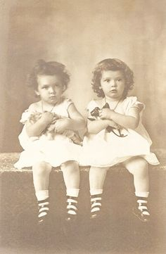 +~+~ Antique Photograph ~+~+   Twins girls hugging their toys as tight as can be.