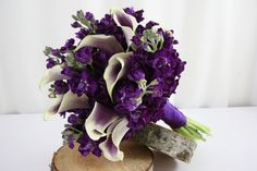 Simple elegance. Purple Stock and Miniature Picasso Calla Lilies in a hand-tied bouquet.  Flowers by A Floral Affair. #AFloralAffair #Wedding #Bouquet