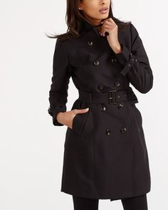 """Step up your outerwear game with this Belted Trench Coat. Effortlessly chic, this classic, double breasted style is flattering and comfortable. Featuring front pockets and button tab details on sleeve cuffs. A must-have for spring!<br /><br />Length: 36.5"""""""